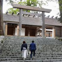 People visit the inner sanctum of Ise Shrine Wednesday in Ise, Mie Prefecture. | KYODO