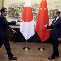 Foreign ministers of Japan and China OK plan to boost bilateral ties