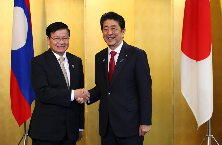 Abe to visit laos in september for asean summit talks the japan times prime minister shinzo abe and laos prime minister thongloun sisoulith greet each other before a meeting in nagoya on saturday sisoulith was in japan to m4hsunfo