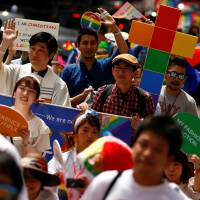 Marchers take part in the Tokyo Rainbow Parade on May 8. Non-Japanese gay people say they feel less physically threatened in Japan than in the West, but many complain about the assumption that everyone is straight. | REUTERS