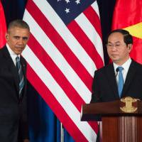 U.S. President Barack Obama and Vietnam President Tran Dai Quang take part in a joint news conference in Hanoi on Monday. | AFP-JIJI