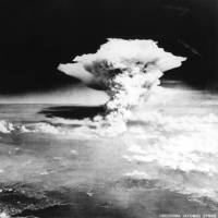 A cloud of dust and smoke billows over Hiroshima after the detonation of the first atomic bomb in this handout photo taken by the U.S. Army on Aug. 6, 1945, and distributed by the Hiroshima Peace Memorial Museum. | REUTERS