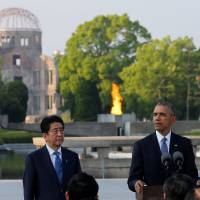 U.S. President Barack Obama delivers remarks after laying a wreath at Hiroshima Peace Memorial Park on Friday as Prime Minister Shinzo Abe looks on. | REUTERS