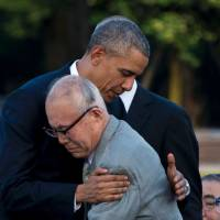 Obama's hug of Hiroshima survivor epitomizes historic visit