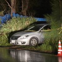 Police Thursday find the body of Rina Shimabukuro among weeds in the village of Onna, Okinawa Prefecture, based on the statements of Kenneth Franklin Shinzato, who was arrested on suspicion of killing her.   KYODO