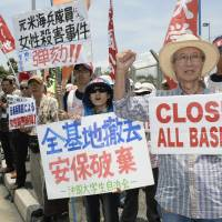 Angry Okinawans rally at Kadena Air Base following ex-marine's arrest