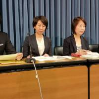 Hiroki Komazaki (left) and other anti-poverty advocates announce the launch of an online petition drive to call for the establishment of a government scholarship program for aspiring university students at a news conference in Tokyo Monday. | TOMOHIRO OSAKI