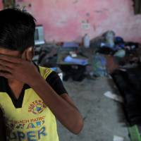 This file photo taken on Nov. 10, 2009, shows an Indian child laborer crying during a raid and rescue operation  in New Delhi. More than 45 million men, women and children globally are trapped in modern slavery. | AFP-JIJI