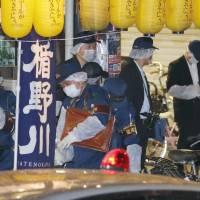 Police investigate the scene of the stabbing of female idol Mayu Tomita in the city of Koganei, Tokyo, on Saturday. | KYODO