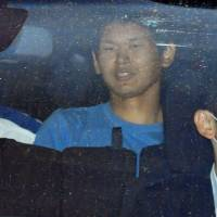 Tomohiro Iwazaki, arrested following Saturday's stabbing of singer Mayu Tomita, is transported from Koganei Police Station in western Tokyo on Monday. | KYODO