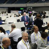 Journalists from across the world prepare coverage of the Group of Seven summit meeting at the International Media Center in Ise, Mie Prefecture, on Wednesday. | REIJI YOSHIDA