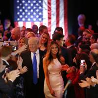 Republican presidential candidate Donald Trump and his wife, Melania, arrive to speak to supporters at Trump Tower in Manhattan on Tuesday following his victory in the Indiana primary.   GETTY / KYODO