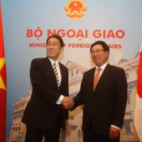 Foreign Minister Fumio Kishida meets with Vietnamese Deputy Prime Minister and Foreign Minister Pham Binh Minh during their talks in Hanoi on Thursday. | AFP-JIJI