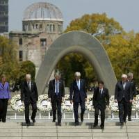 Foreign ministers from the Group of Seven nations pay their respects at Hiroshima Peace Memorial Park in April. U.S. President Barack Obama plans to visit the city on May 27. | REUTERS
