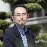 Futoshi Taga, a professor at the Department of Education and Culture at Kansai University, poses for a photo in Tokyo on April 25. | ROB GILHOOLY