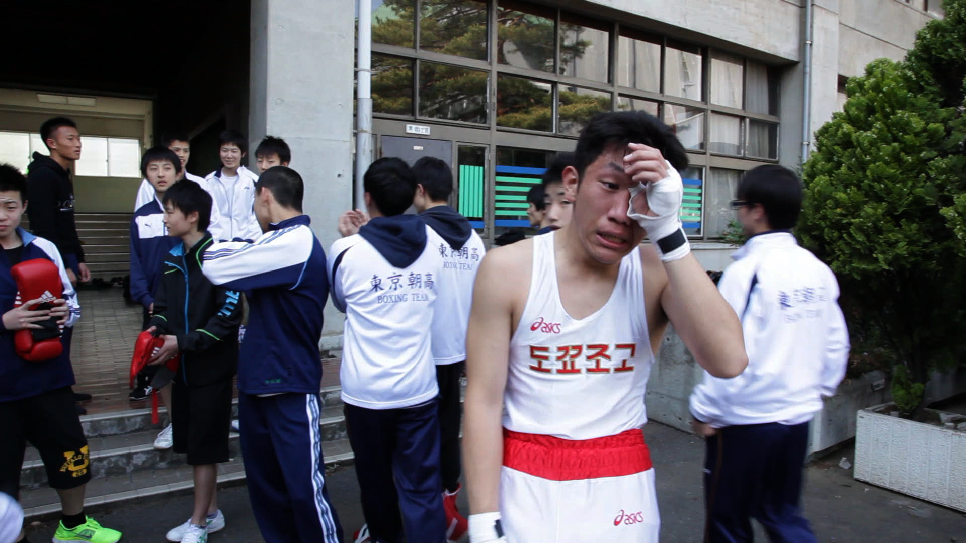Fighting for a place in Japan: Lee Il-ha's 2015 documentary 'A Crybaby Boxing Club,' about North Korea-affiliated Joseon High School in Tokyo, highlights the identity crisis suffered by many resident Koreans by focusing on the school's boxing club. They have to win at any price, especially when they fight boxers from Japanese schools, but the emotional cost is so high that they break down in tears after every bout. | WAFACTORY