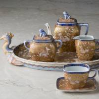 Coffee set with phoenix-shaped tray sporting a design of a kirin (a mythical creature), birds and flowers in overglaze polychrome enamels (1875-80s) by Koransha | COLLECTION OF SHOBIDO-HONTEN CO., LTD., PHOTOs\ BY SEKAI BUNKASHA