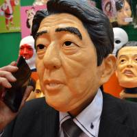 Pun-tastic: Prime Minister Shinzo 'Anxiety Doubles' Abe and his ruling 'Party of People who Suffer from Piles' have felt the sharp end of the skewer of political satire. | AFP-JIJI