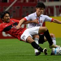 Ugajin strike puts Urawa in driving seat against Seoul