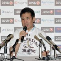 Ryukyu coach Tsutomi Isa speaks at a post-game news conference on Sunday after leading the Golden Kings to a 86-74 championship game victory over the Toyama Grouses at Ariake Colosseum. It was Isa's second title as in three seasons as head coach. | YOSHIAKI MIURA