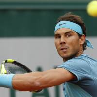Nadal breezes past Groth into French Open second round
