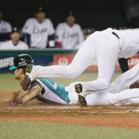 Fighters get pair of runs on wild pitch in decisive sixth inning, trounce Lions