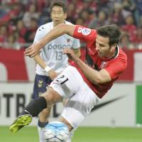 Reds reach Asian Champions League round of 16