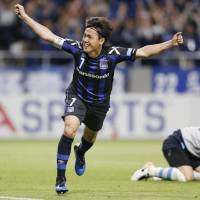 Gamba Osaka captain Yasuhito Endo celebrates his 66th-minute goal against Jubilo Iwata on Friday night in Suita, Osaka Prefecture. Endo scored the winning goal in Gamba's 2-1 triumph. | KYODO