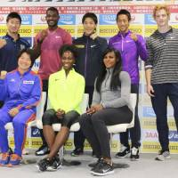 Sprinter Justin Gatlin (back row, second from left) and other competitors for Sunday's Golden Grand Prix meet in Kawasaki pose for a photo on Saturday at Todoroki Stadium. | KAZ NAGATSUKA