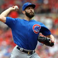 Arrieta moves to 9-0 as Cubs edge Cards