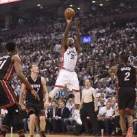Raptors outlast Heat in OT to even series