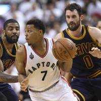 Cavaliers teammates Kevin Love (0) and Kyrie Irving, seen defending the Raptors' Kyle Lowry on Monday, are an integral part of the team's run to the Eastern Conference finals this season. | AP