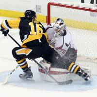 Penguins win in OT to knock out Capitals