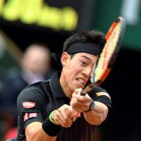 After rain delay, Nishikori bags 50th Grand Slam win in French Open opener
