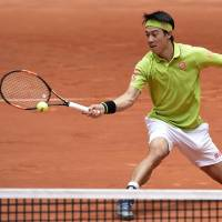 Nishikori downs Gasquet to make Madrid Open quarters