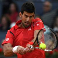 Djokovic downs Nishikori to set up final against Murray