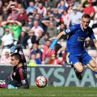 Leicester City striker Jamie Vardy (right) became the first player to score in 11 successive Premier League matches this season. | AP