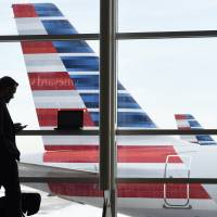 American joins U.S. rivals, bases frequent flier awards on money spent, not miles flown