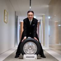 Bridgestone CEO sees father of bride role for top team in deals