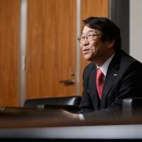 Kenji Sukeno, president of Fujifilm Holdings Corp., is interviewed in Tokyo on Thursday. Fujifilm is targeting 20 percent operating margins in its drug operations and aims to make the business profitable in the fiscal year starting April 2018, he said. | BLOOMBERG