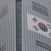 Lotte chairman beats back brother's third attempt at ouster