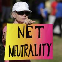 Lori Erlendsson attends a pro-net neutrality Internet activist rally in the neighborhood where U.S. President Barack Obama attended a fundraiser in Los Angeles in 2014. | REUTERS