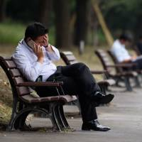 Abenomics brings salarymen no relief as wives limit allowances