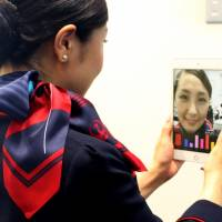 Cosmetics firm Shiseido rolls out smile-rating app