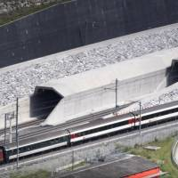 Swiss fete $12 billion 57-km rail tunnel, world's longest, deepest