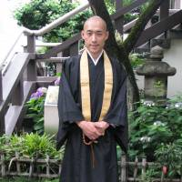 On the job: Buddhist monk Shoukei Matsumoto is seen after a full day's work at Komyoji Temple in Tokyo. Matsumoto, 36, has initiated various projects in order to rebuild the lost temple community in Japan. | KYODO