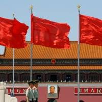 Paramilitary solders stand guard in Beijing's Tiananmen Square on May 16. | REUTERS