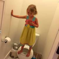 U.S. mom's picture of daughter, 3, practicing shooter lockdown drill goes viral