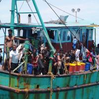 Indonesia lets migrants ashore after week on stranded boat