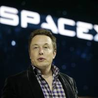 SpaceX CEO Elon Musk, shown in a file photo, said in an interview at tech news site Recode's Code Conference in Southern California on Wednesday that people will be on Mars in 2025. | AP